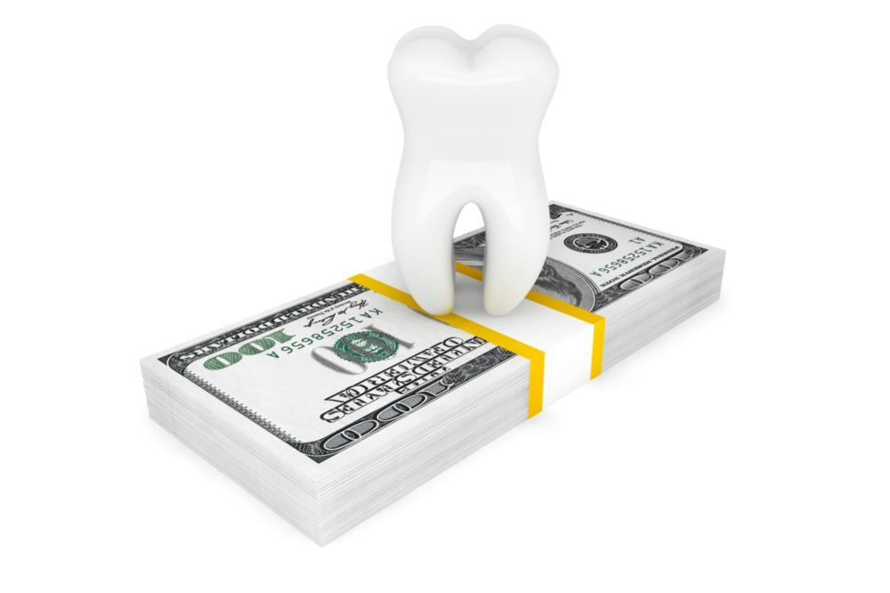 an animated image of a tooth sitting on top of a stack of dollar bills | dentist grapevine
